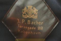 J.P. Bacher.